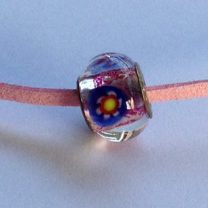 Pink glittery glass bead with blue flower on pink faux suede
